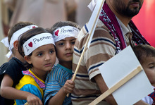 Children wear headbands reading 'I love Prophet' as they ride on a motorbike during a demonstration that is part of widespread anger across the Muslim world about a film ridiculing Islam's Prophet Muhammad, Saturday, Sept. 22, 2012 in Islamabad, Pakistan. (AP Photo/Anjum Naveed)
