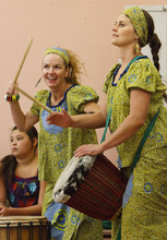 Leah Hogsten  |  The Salt Lake Tribune Drummers Rosie Banchero (left) and Whitney Hobson (right) keep the African drum beat. Students and teachers at Cottonwood Elementary were treated to dancers and musicians showcasing the culture of Africa as part of the school's Friend to Friend service project for children in the Samburu District of the Rift Valley Province, Kenya, Friday, September 21, 2012. . The goal of the project is for Cottonwood students to make personal connections with the children in Africa.