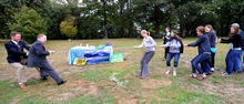 Local groups from Pittsburgh take part in a Frackdown Smackdown tug-of-war between college students representing the