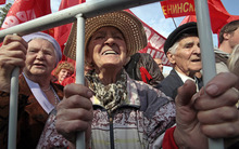 Russian Communists Party supporters hold  Communist Party flags, as they protest against increasing of prices for communal services, in Moscow, Russia, Saturday, Sept. 22, 2012. (AP Photo/Mikhail Metzel)