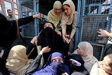 Indian policewomen detain members of the radical Islamic women's group Dukhtaran-e-Millat, or daughters of the nation, during a protest opposing anti-Islam film