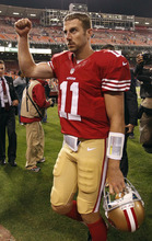 San Francisco 49ers quarterback Alex Smith celebrates at the end of a win over the Detroit Lions during an NFL football game in San Francisco, Sunday, Sept. 16, 2012. San Francisco won 27-19.  (AP Photo/Tony Avelar)