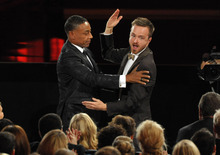 Giancarlo Esposito, left, congratulates Aaron Paul after Paul won the award for outstanding supporting actor in a drama series for