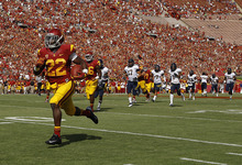 Southern California running back Curtis McNeal, left, runs with the ball during the first half of an NCAA college football game against California in Los Angeles, Saturday, Sept. 22, 2012. (AP Photo/Jae C. Hong)