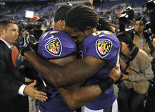 Baltimore Ravens linebacker Ray Lewis, left, hugs wide receiver Torrey Smith after an NFL football game against the New England Patriots in Baltimore, Monday, Sept. 24, 2012. Baltimore won 31-30. Smith, who was playing less than 24 hours after the death of his 19-year-old brother, had six catches for 127 yards and two touchdowns for the Ravens. (AP Photo/Gail Burton)