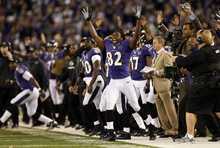 Baltimore Ravens wide receiver Torrey Smith (82) reacts after kicker Justin Tucker kicked a field goal in the second half of an NFL football game against the New England Patriots in Baltimore, Sunday, Sept. 23, 2012. New England won 31-30. (AP Photo/Patrick Semansky)