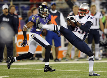 New England Patriots wide receiver Brandon Lloyd, right, makes a catch in front of Baltimore Ravens cornerback Cary Williams in the second half of an NFL football game in Baltimore, Sunday, Sept. 23, 2012. (AP Photo/Nick Wass)
