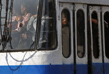 In this photo taken Saturday, Sept. 22, 2012, a North Korean man looks out from a broken window of a bus in Pyongyang, North Korea. (AP Photo/Vincent Yu)