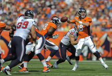 Denver Broncos quarterback Peyton Manning (18) throws against the Houston Texans in the first quarter of an NFL football game Sunday, Sept. 23, 2012, in Denver. (AP Photo/Jack Dempsey)