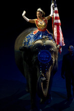 Kim Raff | The Salt Lake Tribune A women rides on top of an elephant during the National Anthem on opening night of the Ringling Bros. Barnum & Bailey Circus show Dragons at the Energy Solutions Arena in Salt Lake City on Sept. 20, 2012.