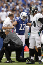 Indianapolis Colts wide receiver Austin Collie is assisted after being injured during the second half of an NFL football game against the Jacksonville Jaguars in Indianapolis, Sunday, Sept. 23, 2012. (AP Photo/AJ Mast)
