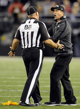 Baltimore Ravens head coach John Harbaugh, right, argues a call with head linesman Rodney Russell in the second half of an NFL football game against the New England Patriots in Baltimore, Sunday, Sept. 23, 2012. (AP Photo/Nick Wass)