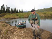 Mike Overcast, operations manager of the Tordrillo Mountain Lodge in Alaska, prepares to lead a group of anglers down Talachulitna Creek armed with colorful flies and a bear gun.  | Brett Prettyman/The Salt Lake Tribune