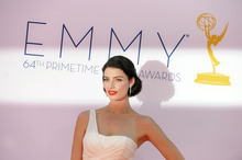 Actress Jessica Pare arrives at the 64th Primetime Emmy Awards at the Nokia Theatre on Sunday, Sept. 23, 2012, in Los Angeles.  (Photo by Jordan Strauss/Invision/AP)