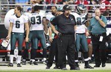 Philadelphia Eagles head coach Andy Reid, front, stands on the sidelines during the second half of an NFL football game against the Arizona Cardinals Sunday, Sept. 23, 2012, in Glendale, Ariz.  The Cardinals defeated the Eagles 27-6.(AP Photo/Paul Connors)