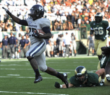Utah State ball carrier Kerwynn Wiliams celebrates after breaking Colorado State tackles and scoring a touchdown during an NCAA college football game in Fort Collins, Colo., Saturday, Sept. 22, 2012. (AP Photo/The Fort Collins Coloradoan, Rich Abrahamson)