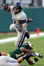 Utah State's Travis Van Leeuwen leaps over Colorado State tackler Jasen Oden during their NCAA college football game in Fort Collins, Colo., Saturday, Sept. 22, 2012. Utah State won 31-19. (AP Photo/The Fort Collins Coloradoan,  Rich Abrahamson)