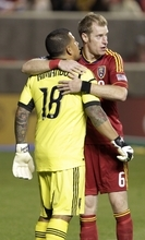 Real Salt Lake goalie Nick Rimando (18) receives a hug from his teammate Nat Borchers (6) at the end of their MLS soccer game with Portland Timbers Saturday, Sept. 22, 2012, in Sandy, Utah. Real Salt Lake defeated Portland Timbers 2-1.  (AP Photo/Rick Bowmer)