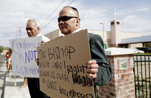 Ashley Detrick  |  The Salt Lake Tribune Keliti Mahe, right, and Sosaia Haukinima protest outside the Tongan United Methodist Church after Rev. Havili Mone was removed over 30 days ago. The protest by members of the West Valley City church on Sunday September 23, 2012 was to show how upset they are that they were not given an explanation for the move and that the replacement pastor locked members out of the church last week.