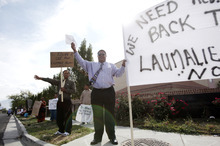 Ashley Detrick  |  The Salt Lake Tribune Daunibau Lotaki waves to passers by during a protest at the Tongan United Methodist Church on Sunday September 23, 2012.  Members of the West Valley City church protested the temporary removal of their pastor, Rev. Havili Mone. The members are upset that they were not given an explanation for the move and that the replacement pastor locked members out of the church last week.