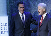 Republican presidential candidate, former Massachusetts Gov. Mitt Romney is introduced by former President Bill Clinton at the Clinton Global Initiative, Tuesday, Sept. 25, 2012, in New York. (AP Photo/Mark Lennihan)