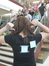 Students at Sunset Ridge Middle School respond to a bully who put a Post-it on a new student's back that read
