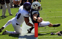 Brigham Young quarterback Taysom Hill, right, scores as Weber State linebacker Anthony Morales (44) defends in the second quarter of an NCAA football game Saturday, Sept. 8, 2012, in Provo, Utah.  (AP Photo/Rick Bowmer)