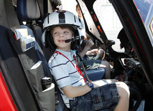 Al Hartmann  |  The Salt Lake Tribune   Mckay Seifer, 7, of Taylorsville, gets a view of the helicopter's controls during  a recent VIP tour of one of the new Life Flight Agusta Grand helicopters that Intermountain Medical Center has purchased.