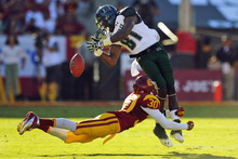 Hawaii wide receiver Chris Gant, top, cannot hold on to a pass as Southern California cornerback Brian Baucham tackles him during the first half of their NCAA college football game, Saturday, Sept. 1, 2012, in Los Angeles. (AP Photo/Mark J. Terrill)