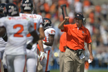 Oregon State Beavers head coach Mike Riley, right, gestures to wide receiver Markus Wheaton, left, after Wheaton scored a touchdown during the first half of their NCAA college football game against UCLA, Saturday, Sept. 22, 2012, in Pasadena, Calif. (AP Photo/Mark J. Terrill)