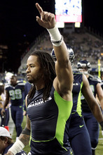 Seattle Seahawks free safety Earl Thomas celebrates their 14-12 win over the Green Bay Packers in an NFL football game, Monday, Sept. 24, 2012, in Seattle. (AP Photo/Stephen Brashear)