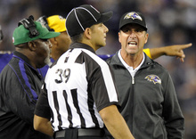Baltimore Ravens head coach John Harbaugh, right, speaks with line judge Esteban Garza in the first half of an NFL football game in Baltimore, Sunday, Sept. 23, 2012. (AP Photo/Nick Wass)