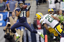 Seattle Seahawks wide receiver Golden Tate (81) catches a pass for a touchdown ahead of Green Bay Packers cornerback Charles Woodson (21) in the first half of an NFL football game, Monday, Sept. 24, 2012, in Seattle. (AP Photo/Stephen Brashear)