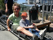 Samantha Simon takes a child down an alpine slide. Courtesy image