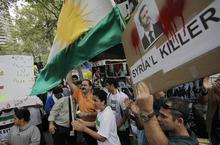 Syrian Americans protest against Syrian President Bashar al-Assad outside the United Nations, Wednesday, Sept. 26, 2012 in New York. (AP Photo/Mark Lennihan)