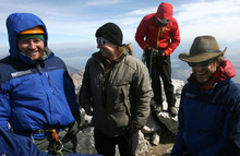 Leah Hogsten  |  The Salt Lake Tribune Veterans Andrew Sullens, Nico Maroulis and Chad Jukes share a light moment on the summit of the Grand Teton. Chad Jukes summed up the challenges the team faced;