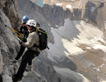 Leah Hogsten  |  The Salt Lake Tribune  Mountaineer Audrey Smith guides veteran Nico Maroulis on her descent from the summit of the Grand Teton. Maroulis had a week and a half to prepare for this trip after agreeing to the trip. She keeps in shape by Olympic weight lifting, but has little climbing experience.