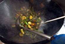 Chris Detrick  |  The Salt Lake Tribune Lead wok chef Ed Wong makes vegetable stir-fry at Harmons City Creek Wednesday September 26, 2012.