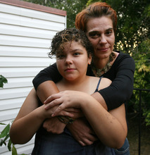 Steve Griffin | The Salt Lake Tribune   Petra Ullmann with her 11-year -old daughter, Johanna Ullmann, outside their Midvale, Utah home Tuesday September 25, 2012.  Petra moved to Utah from Germany in 2005 to join her husband here. They have three daughters and are in the midst of divorcing. She has a temporary work permit and is looking for a job. Her rent is subsidized and she receives food stamps for her children.