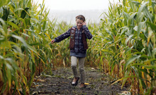 Francisco Kjolseth  |  The Salt Lake Tribune Katie Covington, 8, a Brownie with troop 2038 from Nibley, tries her best to run in the mud Tuesday as Thanksgiving Point in Lehi showed its latest corn maze, which has a presidential campaign theme.