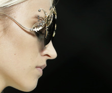 A model wears a creation part of the Roberto Cavalli women's Spring-Summer 2013 collection that was presented in Milan, Italy, Monday, Sept. 24, 2012. (AP Photo/Luca Bruno)