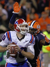 Illinois defensive lineman Michael Buchanan (99) sacks Louisiana Tech quarterback Colby Cameron (10) during the first half of the NCAA college football game Saturday, Sept. 22, 2012, in Champaign, Ill. (AP Photo/Seth Perlman)