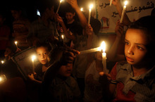 Palestinian children hold candles during a solidarity march with Syria at the Jabaliya Refugee Camp, northern Gaza Strip, Monday, Sept. 24 , 2012. (AP Photo/Hatem Moussa)