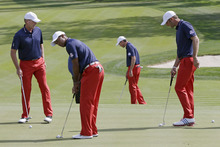 USA's Steve Stricker, left to right, Tiger Woods, Matt Kuchar and Dustin Johnson putt during a practice round at the Ryder Cup PGA golf tournament Wednesday, Sept. 26, 2012, at the Medinah Country Club in Medinah, Ill. (AP Photo/David J. Phillip)