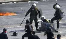 Riot police officers arrest a demonstrator, partially seen on ground, during clashes in Athens Wednesday Sept. 26, 2012. Police clashed with protesters hurling petrol bombs and bottles in central Athens Wednesday after an anti-government rally called as part of a general strike in Greece turned violent. (AP Photo/Dimitri Messinis)