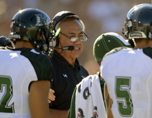 Hawaii head coach Norm Chow talks to members of his team during the first half of their NCAA college football game against Southern California, Saturday, Sept. 1, 2012, in Los Angeles. (AP Photo/Mark J. Terrill)