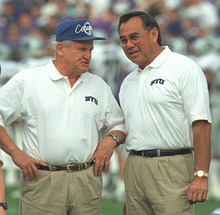 Tribune file photo Norm Chow chats with Lavelle Edwards in this photo shot before the Cotton Bowl in 1997.