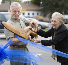 Paul Fraughton | The Salt Lake Tribune Murray Mayor Dan Snarr and Midvale Mayor JoAnn Seghini team up Tuesday, Sept. 25, 2012, to cut a ceremonial ribbon marking the completion of the State Street widening project.