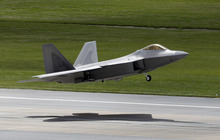 FILE - In this Aug. 14, 2012 file photo, a U.S. Air Force Stealth fighter F-22 Raptor takes off from Kadena Air Base on the southern Japanese island of Okinawa, Japan. Years before F-22 pilots began getting dizzy in the cockpit, before one struggled to breathe as he tried to pull out of a fatal crash, before two more went on television to say the plane was so unsafe they refused to fly it, a small circle of U.S. Air Force experts knew something was wrong with the prized stealth fighter jet.  (AP Photo/Greg Baker, File)