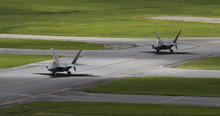 In this Aug. 14, 2012 photo, two U.S. Air Force F-22 Raptor stealth fighters taxi before take-off at Kadena Air Base on the southern island of Okinawa in Japan. The U.S. is hoping a dozen F-22 stealth fighters now roaring through the skies of southern Japan will prove its most prized combat aircraft is finally ready to resume full operations after years of investigations into why its pilots were getting dizzy and disoriented. But questions remain over whether the Air Force has taken enough action to fix a potentially bigger problem - the shriveling of programs to test cockpit life support systems after nearly 20 years of budget cuts, downsizing and outsourcing. (AP Photo/Greg Baker)